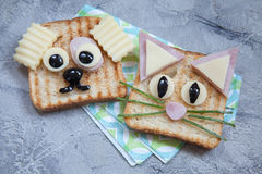 Funny sandwich for kids lunch on a table. Funny dog and cat sandwich for kids lunch on a table Stock Image