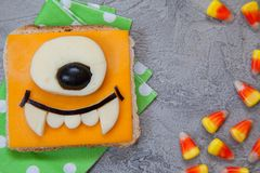 Funny sandwich for kids lunch on a table. Funny monster sandwich for kids lunch on a table royalty free stock image