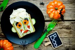 Funny sandwich for kids, vampire face vegetable sandwich. For Halloween royalty free stock photography