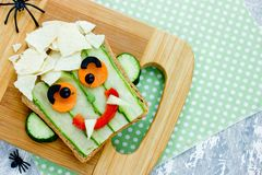 Funny sandwich for kids, vampire face vegetable sandwich. For Halloween royalty free stock photos