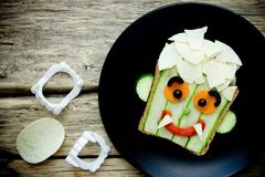 Funny sandwich for kids, vampire face vegetable sandwich. For Halloween royalty free stock image