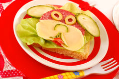 Funny sandwich with puppy for child. Funny sandwich with puppy shape as breakfast for child Stock Photography