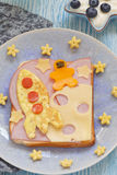 Funny sandwich with rocket and a cosmonaut on the cheese moon Stock Photography