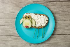 Funny sandwich sheep made on blue plate stock photography