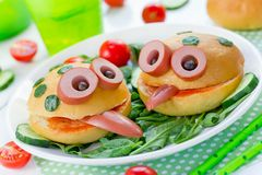 Funny sandwiches for children, animal shaped sandwich like a fro. G with bread bun vegetable and sausage stock photo