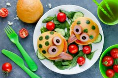 Funny sandwiches for children, animal shaped sandwich like a fro. G with bread bun vegetable and sausage royalty free stock images