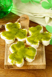 Funny sandwiches in the form of clover with green cheese Royalty Free Stock Images
