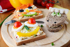 Funny sandwiches for kids with faces Stock Photos