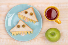 Funny sandwiches for kids in shape of monsters. Cute and Funny sandwiches for kids in shape of monsters, top view stock photo