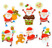 Funny Santa cartoons. Collection of funny cartoon Santa Clauses in different poses Stock Images