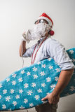 Funny santa claus babbo natale ironing surfer Stock Photo