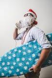 Funny santa claus babbo natale ironing surfer. On white background Stock Photo