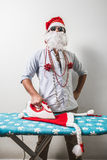 Funny santa claus babbo natale ironing Stock Photos