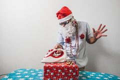 Funny santa claus babbo natale ironing Stock Photo