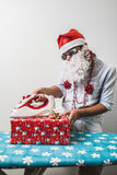 Funny santa claus babbo natale ironing Stock Photography