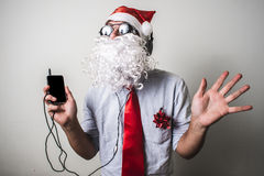 Funny santa claus babbo natale listening music Royalty Free Stock Photo