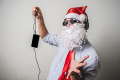 Funny santa claus babbo natale listening music Stock Image
