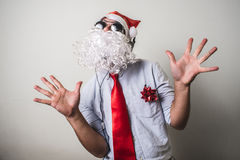 Funny santa claus babbo natale listening music Royalty Free Stock Image