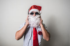 Funny santa claus babbo natale listening music Royalty Free Stock Photography