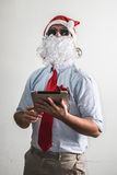 Funny santa claus babbo natale using tablet Stock Images