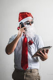 Funny santa claus babbo natale using tablet Stock Photos