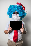 Funny santa claus babbo natale using tablet Stock Photography