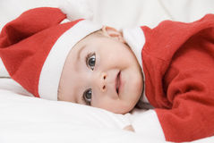 A funny Santa Claus on the bed. royalty free stock image