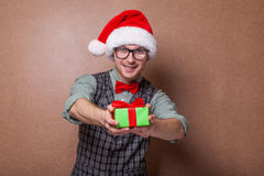 Funny Santa Claus with gift bag. Stock Photo