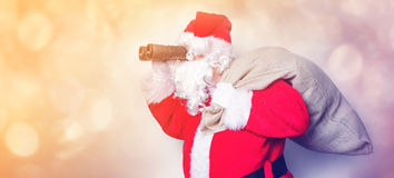 Funny Santa Claus have a fun with binoculars Stock Images