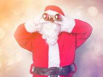 Funny Santa Claus have a fun with binoculars Stock Image