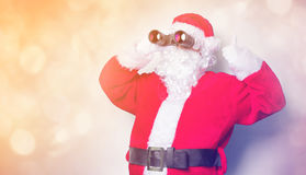 Funny Santa Claus have a fun with binoculars Royalty Free Stock Images