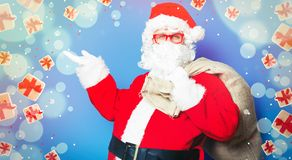 Funny Santa Claus have a fun with red eyeglasses. On blue background Stock Photos