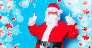 Funny Santa Claus have a fun with red eyeglasses. On blue background Stock Images