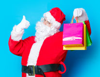 Funny Santa Claus have a fun with shopping bags Stock Photo