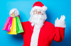 Funny Santa Claus have a fun with shopping bags Stock Photography
