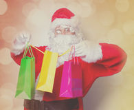 Funny Santa Claus have a fun with shopping bags Royalty Free Stock Photography