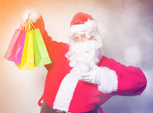 Funny Santa Claus have a fun with shopping bags Royalty Free Stock Images