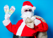 Funny Santa Claus have a fun with vacation flip flops Stock Image