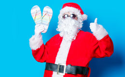 Funny Santa Claus have a fun with vacation flip flops Stock Images