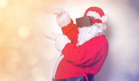 Funny Santa Claus have a joy with VR glasses Stock Photos