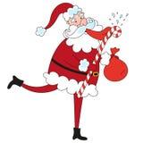 Funny Santa Claus licks big lollipop Stock Images