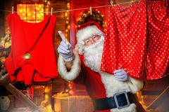 Funny santa claus. Portrait of cheerful Santa Claus in the courtyard of his house decorated with Christmas lights. Christmas and New Year concept stock image