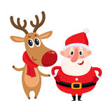 Funny Santa Claus and reindeer in red scarf standing together Stock Photos
