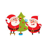 Funny Santa Claus and reindeer in red scarf standing together. Two funny Santa decorate the Christmas tree with festive toys, cartoon vector illustration Royalty Free Stock Image