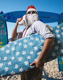 Funny santa claus surfer beach. On holiday Royalty Free Stock Photography
