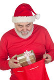 Funny Santa Claus taking a gift from his sack Royalty Free Stock Image