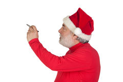 Funny Santa Claus writing with a pen Stock Image