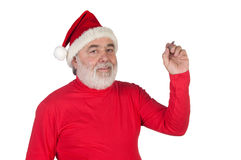Funny Santa Claus writing with a pen Royalty Free Stock Images