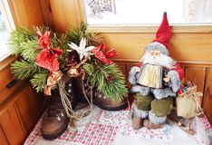 Santa Claus toy, shoose and snow in Dolomity mountains, winter image. Funny Santa Clause, shoose and snow in Dolomiti mountains, in Italy, Europe. Winter toys stock photo