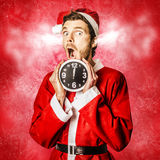 Funny santa in a crazy mad christmas rush Royalty Free Stock Photos